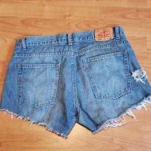 Levi's 550 distressed cut-off jean shorts